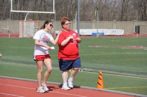 Junior Kate Nance (left) dances down the track during one of the Bishop Champion Games events.
