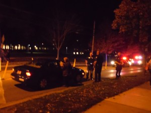 Ohio Wesleyan zoology professor Jed Burtt fills out part of a Delaware Police Department report about the accident involving him and two OWU freshmen Monday evening. The students, Gabriela Colmenares and Hector Rueda, were released from Grant Medical Center and Grady Memorial Hospital late Monday night.