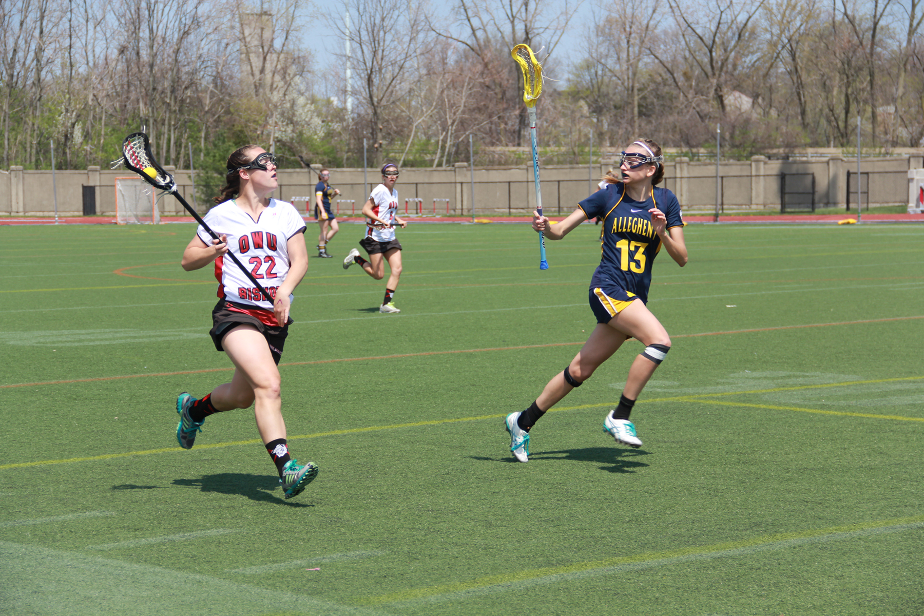 Senior Lori Weischedel looks to pass the ball in the Lady Bishops 12-17 loss to Allegheny April 26 at Selby Stadium.