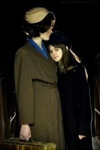 Junior Katie Patrick as Eva leans on junior Margot Reed as Helga.