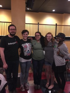 Five members of Active Minds pose in the Milligan Hub at one of their events earlier this semester. Photo courtesy of Facebook.