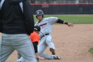 Junior outfielder C.J. Tosino tries to steal third base during a game against Ohio Northern on April 6.  Photo courtesy of Spenser Hickey.