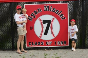 Members of Missler's family stand beside his banner. Photo courtesy of Spenser Hickey.