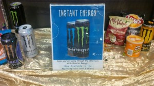 The Monster Energy Drink promotional sign placed on a shelf near food items by Chartwells. Photo by Dan Sweet '16.
