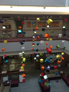 Cubes hang in the Hamilton-Williams Campus Center to advertise the series. Photo courtesy of Sara Hollabaugh.