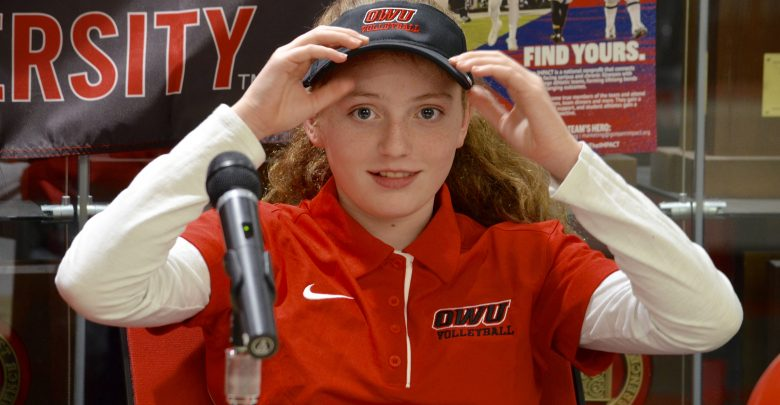 Serena Scilla tries on her new OWU volleyball hat.
