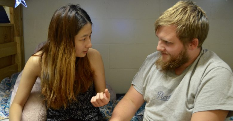 Wang tries to explain her country's stereotypes to Aidan Shumaker.