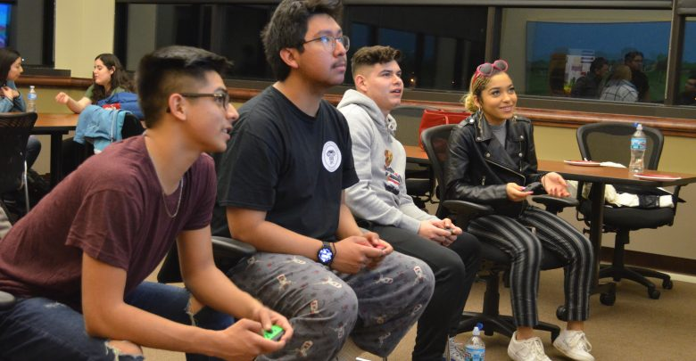Carlos Arroyo Govea, Steven Mora, Jason Mejia and Solara Prastalo play Super Smash Bros.