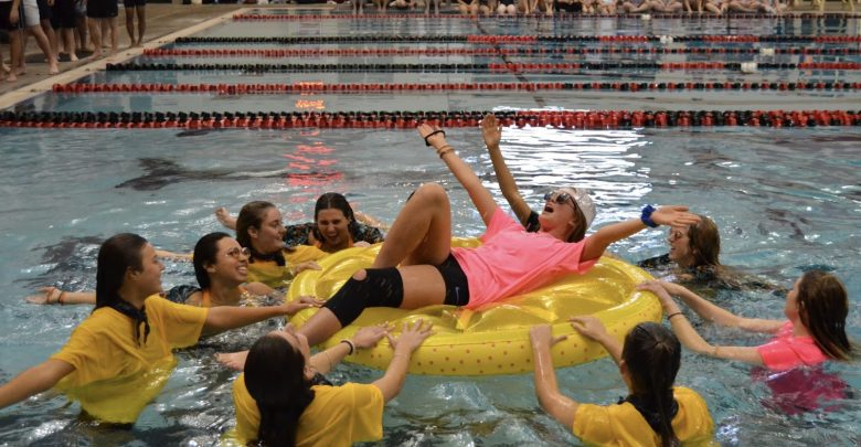 Sisters of Delta Delta Delta spin sophomore Maggie Morse on floatie during synchronized routine.