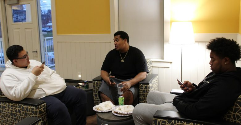 Sean Ainsworth, Nicholas Cooper and Makael Khaaliq ate together and shared a conversation at the House of Black Culture's Game Night.