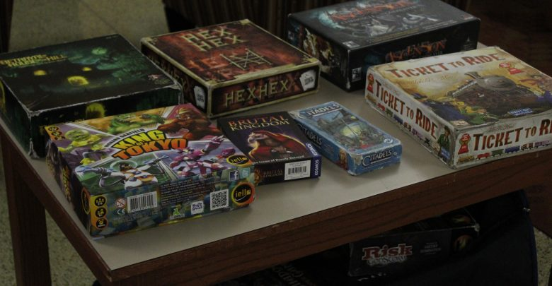 Board games lay out across the various tables in Stuyvesant Hall's lobby during Game Night.