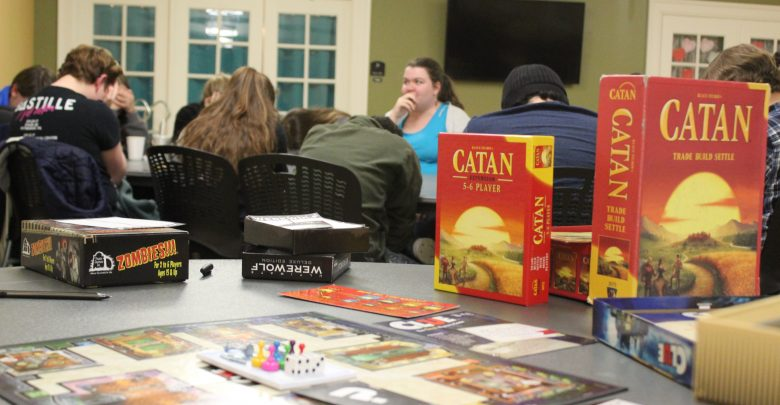 OWU Students gather in the lobby of Stuyvesant Hall for a game night put on by Boardgame Club.