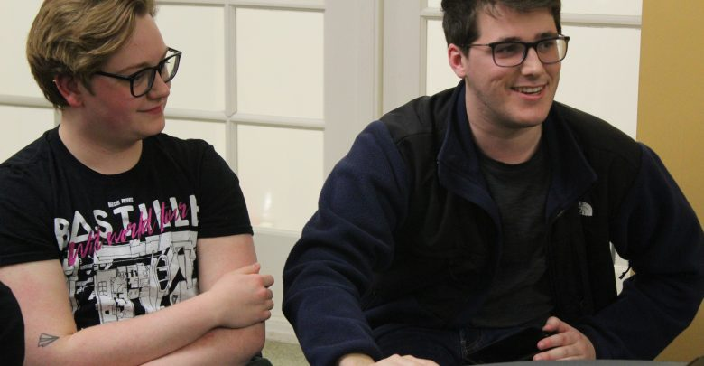 From left to right, OWU students Emery Manz and Colin O'Brian participate in Game Night.