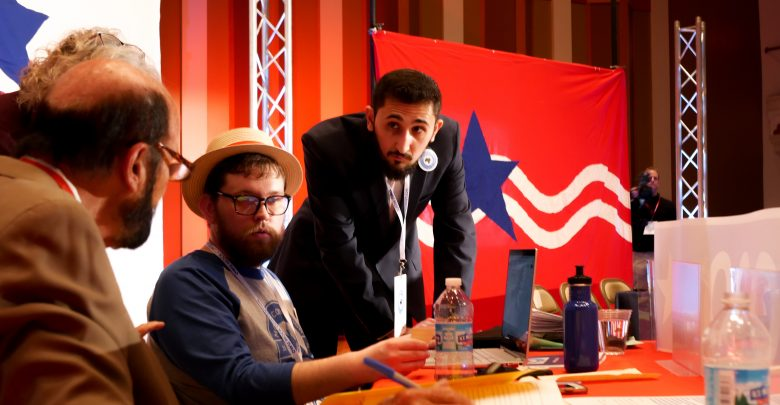 From left to right, Bill Louthn, Greg Margevicius and Ahmed-Hamed cast votes at Mock Convention. Photo by Connor Severino.