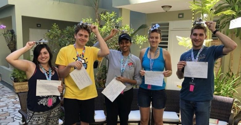 From left to right, Annelise Hernandez, Dylan Hays, Selam Weldu, Avianna Carmoega and Duncan Copeland pose for their homemade commencement ceremony while on a service trip in Puerto Rico over spring break.